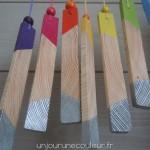 Suspensions tranches de planche en bois peint